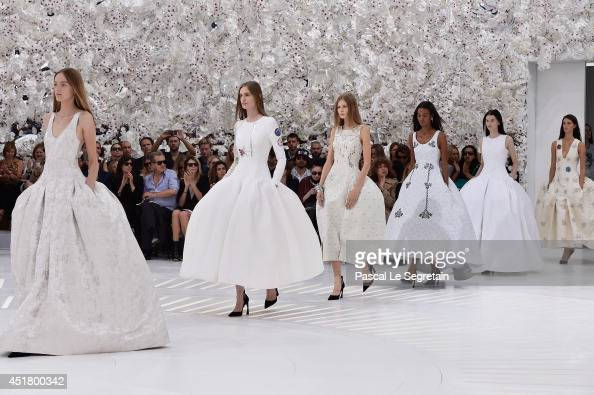Models walk the runway during the Christian Dior show as part of Paris Fashion Week Haute Couture Fall/Winter 20142015 on July 7 2014 in Paris France