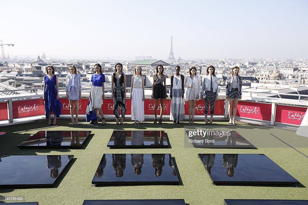 Models walk the runway during the Christine Phung show as part of the Paris Fashion Week Womenswear Spring/Summer 2014 at Galeries Lafayette on September 24, 2013 in Paris, France.