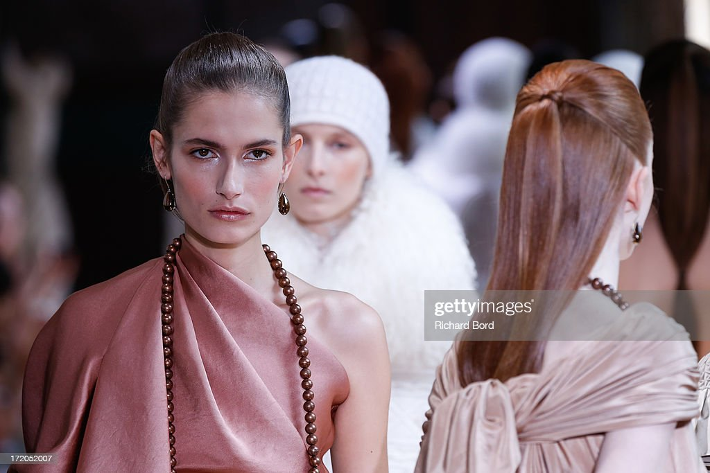 Models walk the runway during the Christophe Josse show as part of Paris Fashion Week Haute-Couture Fall/Winter 2013-2014 at les Beaux Arts on July 1, 2013 in Paris, France.