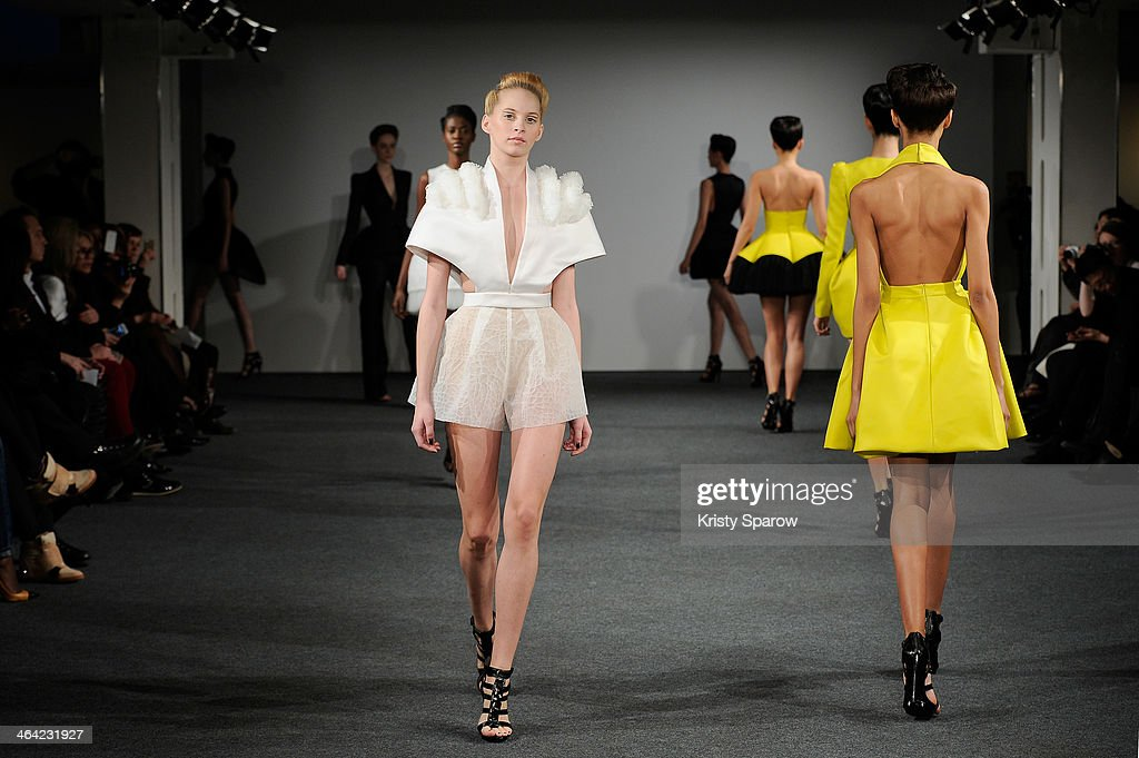 Models walk the runway during the Clarisse Hieraix show as part of Paris Fashion Week Haute Couture Spring/Summer 2014 on January 21, 2014 in Paris, France.