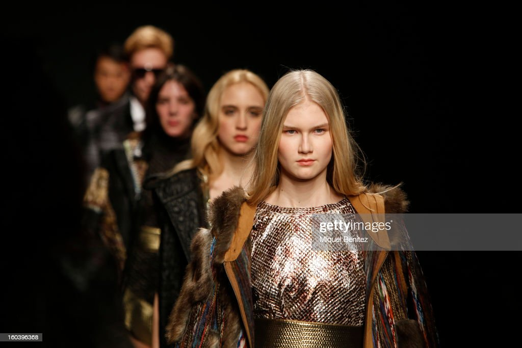 Models walk the runway during the Custo Barcelona fashion show as part of the 080 Barcelona Fashion Week Autumn/Winter 2013-2014 on January 30, 2013 in Barcelona, Spain.