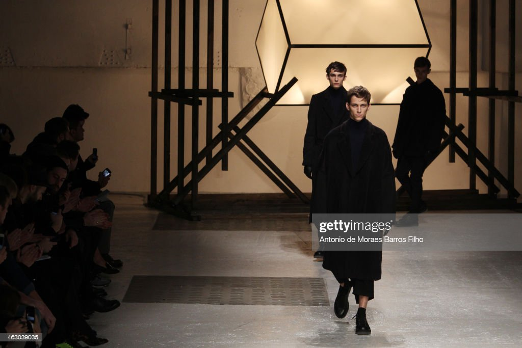 Models walk the runway during the Damir Doma Menswear Fall/Winter 2014-2015 show as part of Paris Fashion Week on January 16, 2014 in Paris, France.
