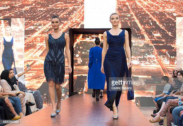 Models walk the runway during the Debenhams show at Yas Mall Fashion Week on October 15 2015 in Abu Dhabi United Arab Emirates