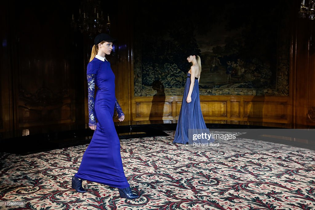 A models walk the runway during the Didit Hediprasetyo show as part of Paris Fashion Week Haute-Couture Fall/Winter 2013-2014 at Hotel Le Bristol on July 4, 2013 in Paris, France.