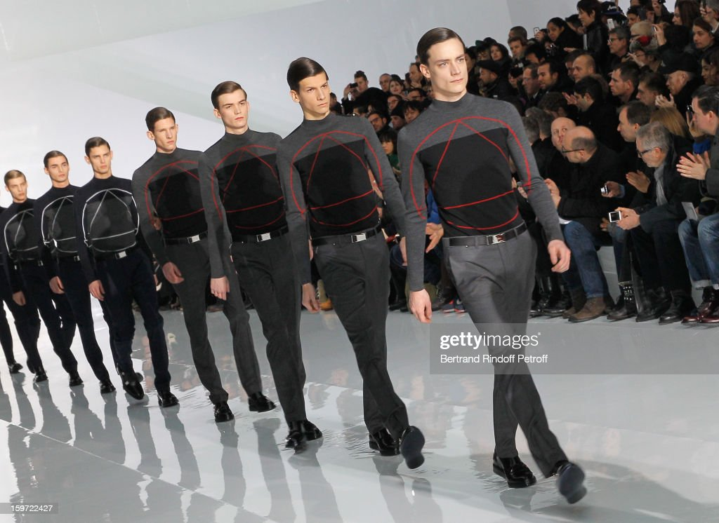 Models walk the runway during the Dior Homme Men Autumn / Winter 2013 show as part of Paris Fashion Week, at Quartier des Celestins on January 19, 2013 in Paris, France.