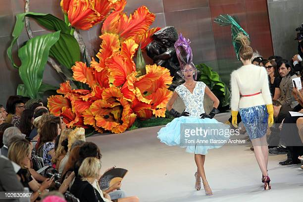 Models walk the runway during the Dior show as part of the Paris Haute Couture Fashion Week Fall/Winter 2011 at Musee Rodin on July 5 2010 in Paris...