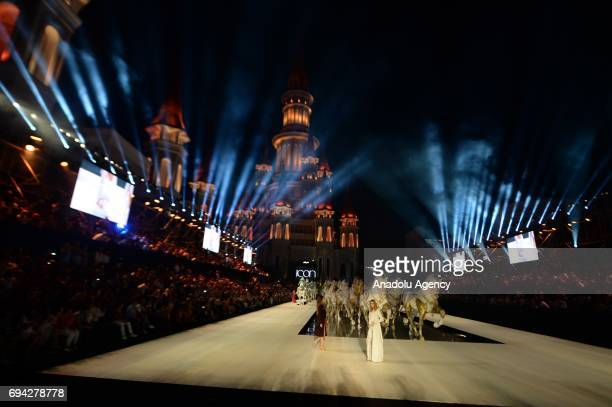 Models walk the runway during the Dosso Dossi Fashion Show in Antalya Turkey on June 09 2017