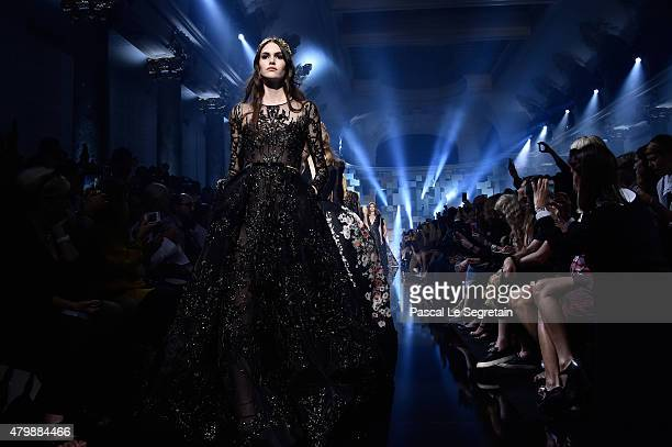 Models walk the runway during the Elie Saab show as part of Paris Fashion Week Haute Couture Fall/Winter 2015/2016 on July 8 2015 in Paris France