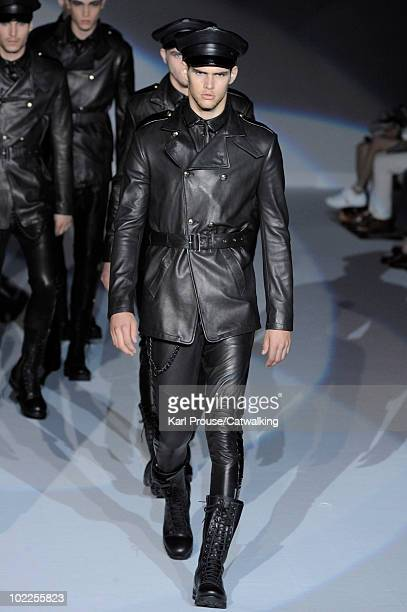 Models walk the runway during the Emporio Armani fashion show at Milan Menswear Fashion Week for Spring Summer 2011 on June 20 2010 in Milan Italy