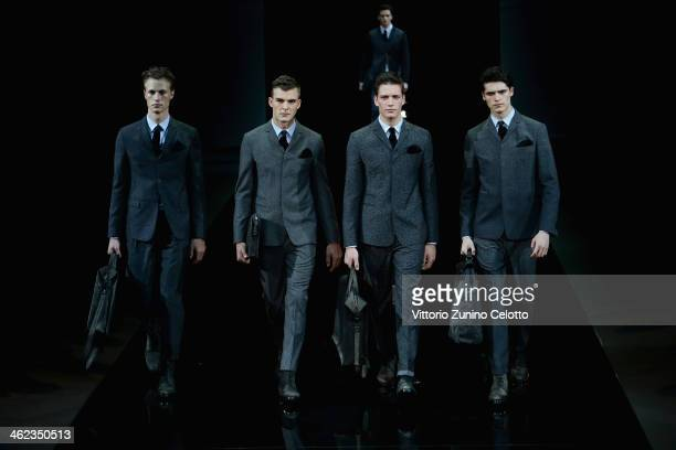 Models walk the runway during the Emporio Armani show as a part of Milan Fashion Week Menswear Autumn/Winter 2014 on January 13 2014 in Milan Italy