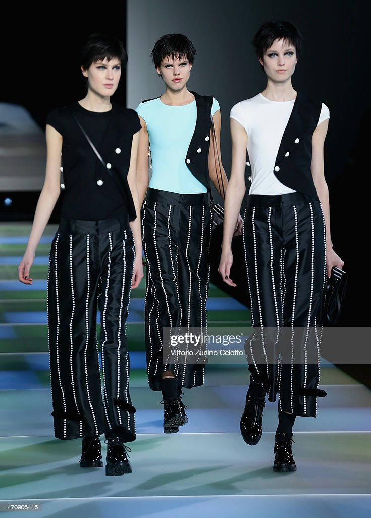 Models walk the runway during the Emporio Armani show as part of Milan Fashion Week Womenswear Autumn/Winter 2014 on February 21, 2014 in Milan, Italy.