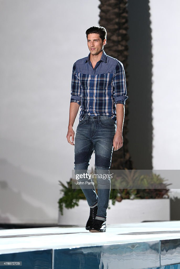 Models walk the runway during the EXPRESS South Beach Runway Show at The Raleigh Hotel on March 13, 2014 in Miami, Florida.