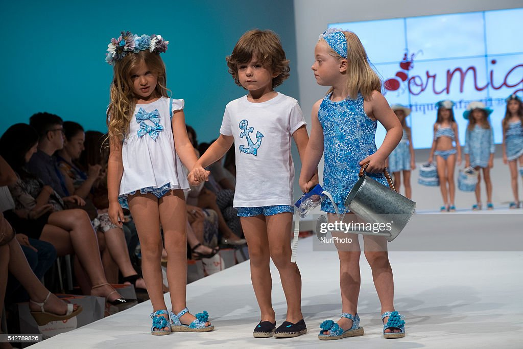 Models walk the runway during the FIMI (Feria de Moda Infantil) at Pabellon de Cristal de la Casa de Campo on June 24, 2016 in Madrid, Spain.