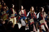 Models walk the runway during the finale at Burberry Womenswear Autumn/Winter 2014 at Kensington Gardens on February 17 2014 in London England