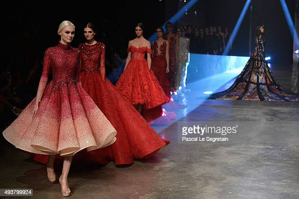 Models walk the runway during the Finale at the Michael Cinco show during Dubai Fashion Forward Spring/Summer 2016 at Madinat Jumeirah on October 22...
