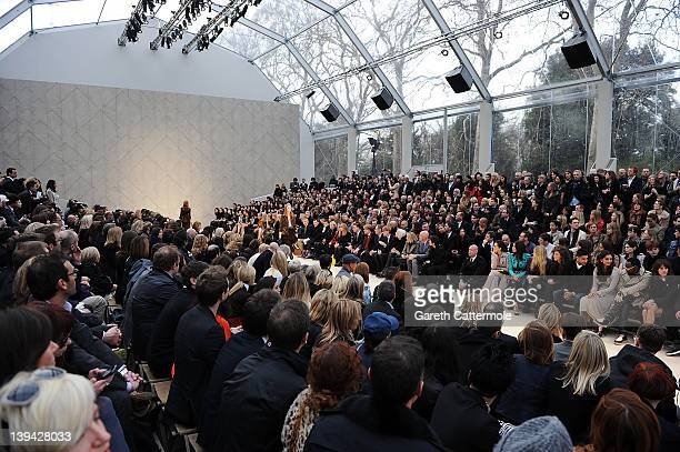 Models walk the runway during the finale of the Burberry Autumn Winter 2012 Womenswear Front Row during London Fashion Week at Kensington Gardens on...