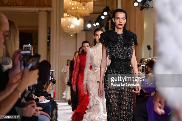 Models walk the runway during the Giambattista Valli show as part of the Paris Fashion Week Womenswear Fall/Winter 2017/2018 on March 6 2017 in Paris...
