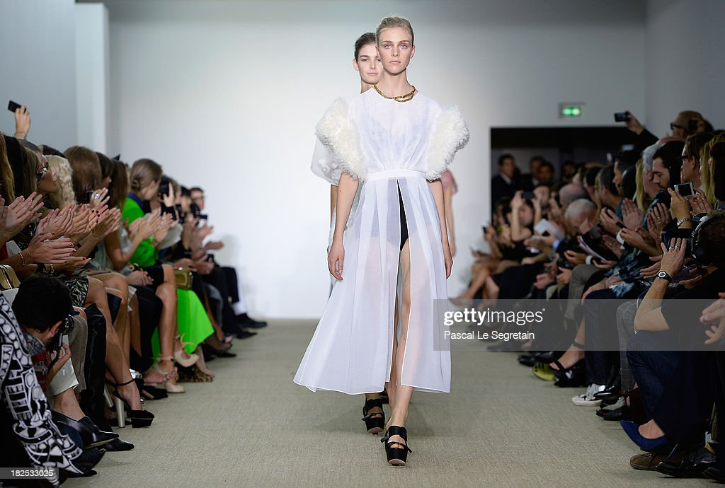 Models walk the runway during the Giambattista Valli show finale as part of the Paris Fashion Week Womenswear Spring/Summer 2014 on September 30, 2013 in Paris, France.