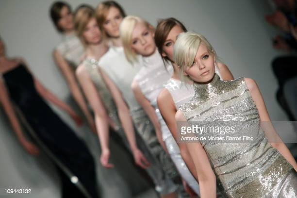 Models walk the runway during the Gianfranco Ferre show as part of Milan Fashion Week Week Womenswear Autumn/Winter 2011 on February 25 2011 in Milan...