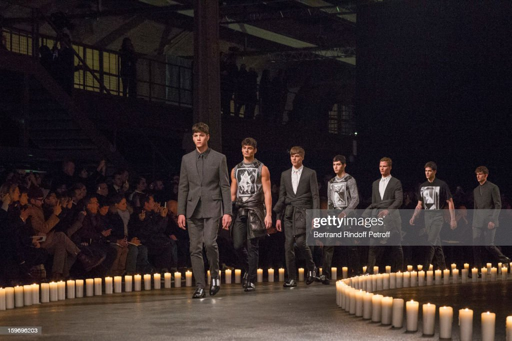 Models walk the runway during the Givenchy Men Autumn / Winter 2013 show as part of Paris Fashion Week on January 18, 2013 in Paris, France.