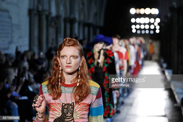 Models walk the runway during the Gucci Cruise 2017 fashion show at the Cloisters of Westminster Abbey on June 2 2016 in London England