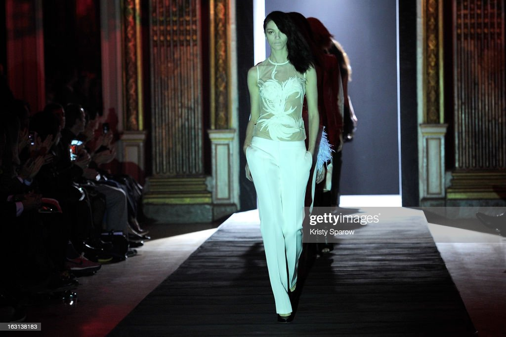 Models walk the runway during the Hakaan Fall/Winter 2013/14 Ready-to-Wear show as part of Paris Fashion Week on March 5, 2013 in Paris, France.