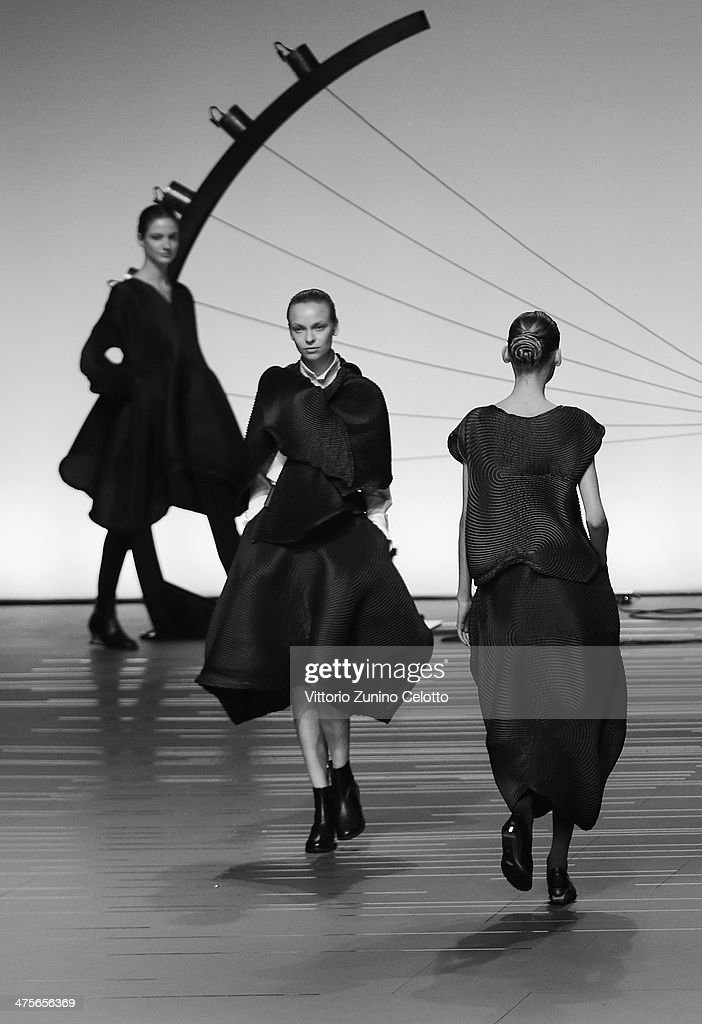 Models walk the runway during the Issey Miyake show as part of the Paris Fashion Week Womenswear Fall/Winter 2014-2015 at Espace Vendome on February 28, 2014 in Paris, France.