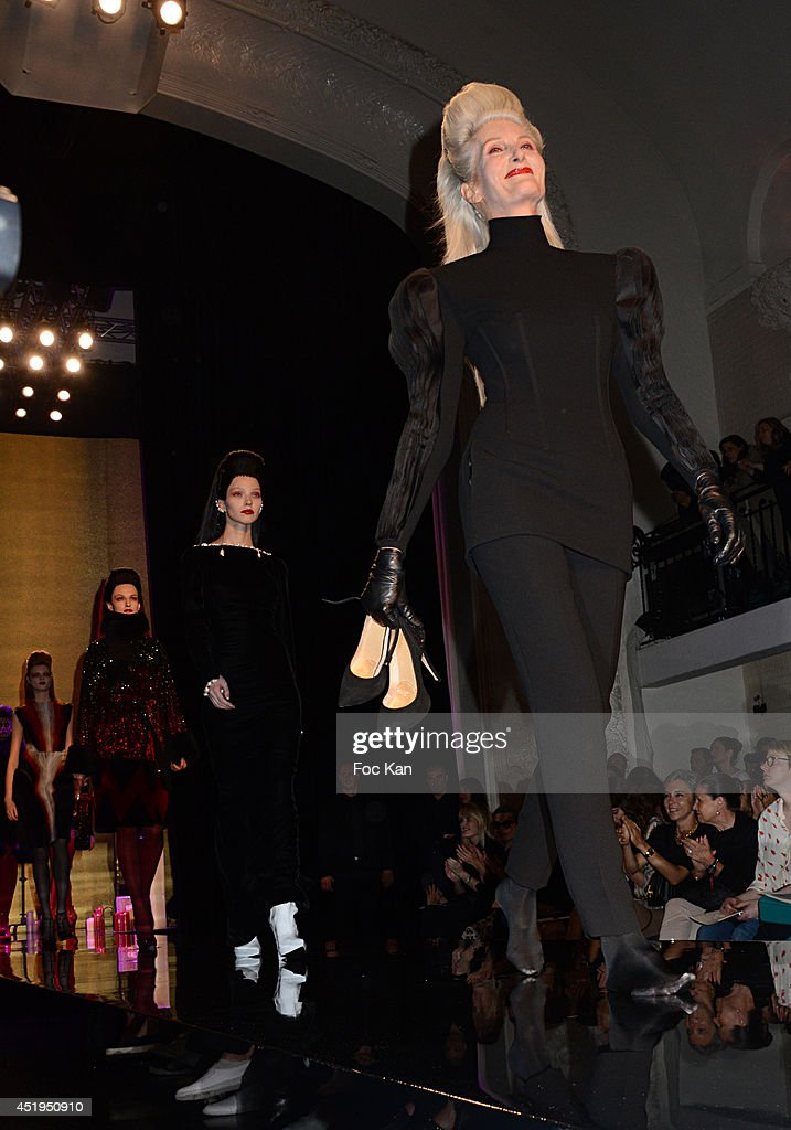Models walk the runway during the Jean Paul Gaultier show as part of Paris Fashion Week - Haute Couture Fall/Winter 2014-2015 at 325 Rue Saint Martin on July 9, 2014 in Paris, France.