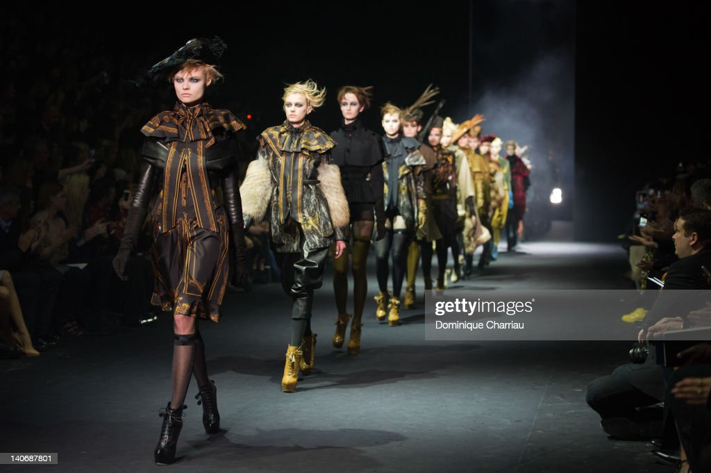 Models walk the Runway during the John Galliano Ready-To-Wear Fall/Winter 2012 show as part of Paris Fashion Week at Espace Ephemere Tuileries on March 4, 2012 in Paris, France.
