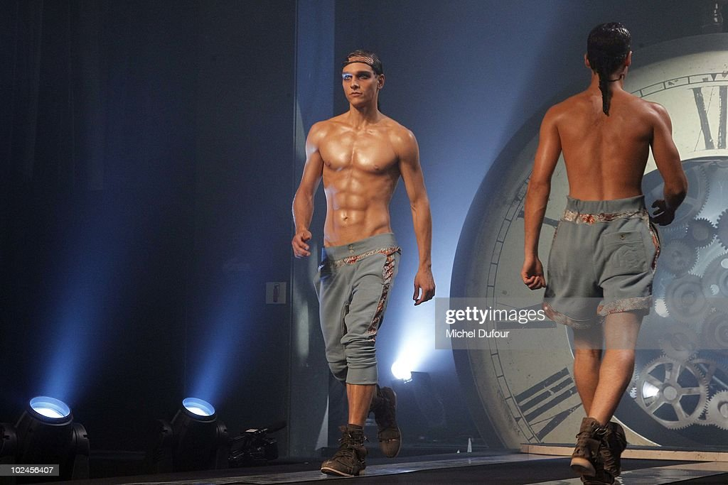 Models walk the runway during the John Galliano show as part of Paris Menswear Fashion Week Spring/Summer 2011 on June 25, 2010 in Paris, France.