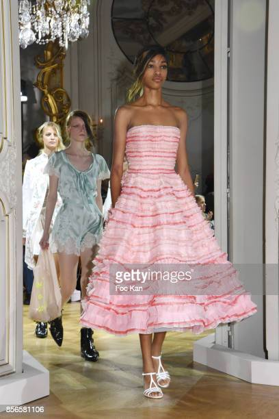 Models walk the runway during the John Galliano show as part of the Paris Fashion Week Womenswear Spring/Summer 2018 on October 1 2017 in Paris France