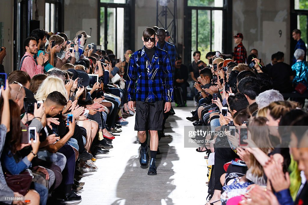 Models walk the runway during the John Lawrence Sullivan Menswear Spring/Summer 2014 show at Palais de Tokyo as part of the Paris Fashion Week on June 26, 2013 in Paris, France.
