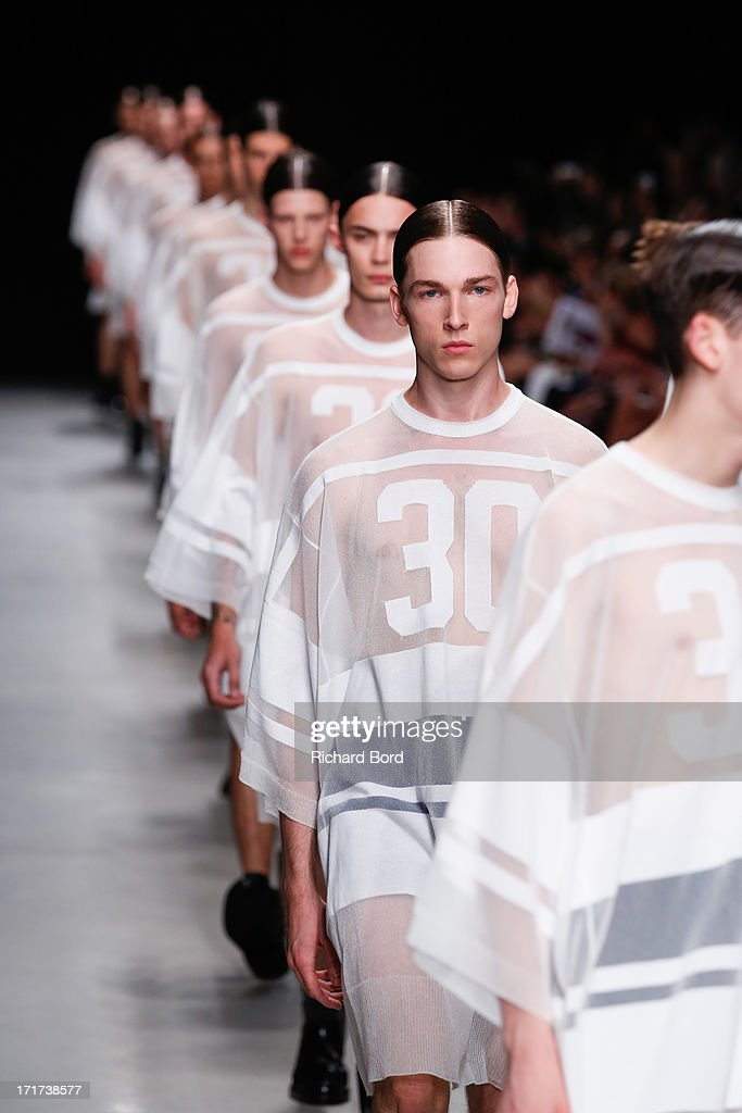 Models walk the runway during the Juun.J Menswear Spring/Summer 2014 show at Palais de Tokyo as part of the Paris Fashion Week on June 28, 2013 in Paris, France.