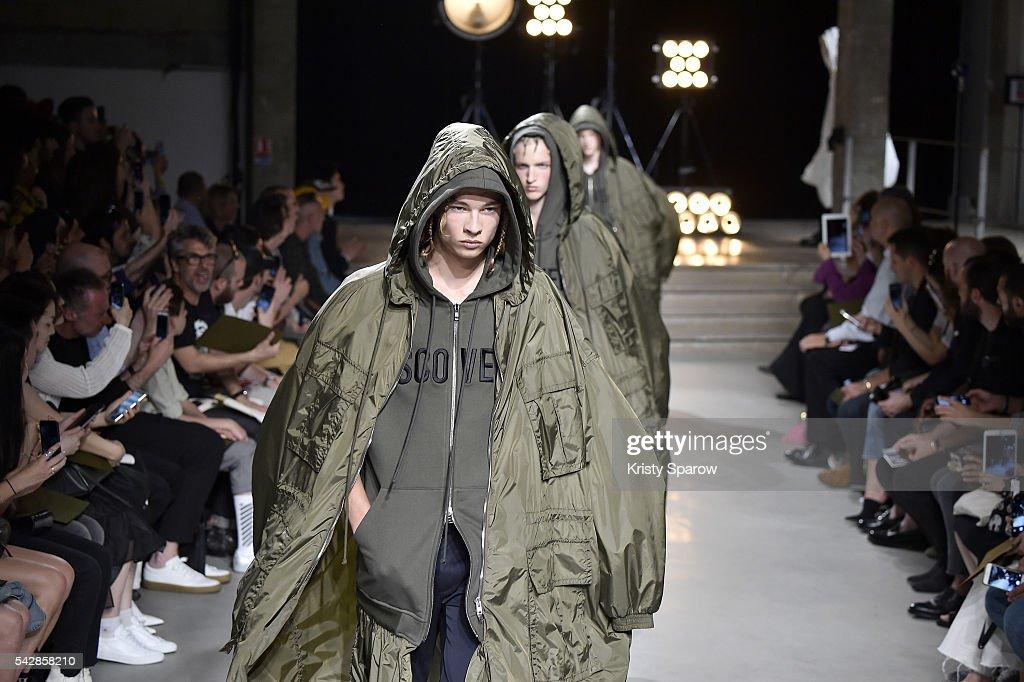 Models walk the runway during the Juun.J Menswear Spring/Summer 2017 show as part of Paris Fashion Week on June 24, 2016 in Paris, France.