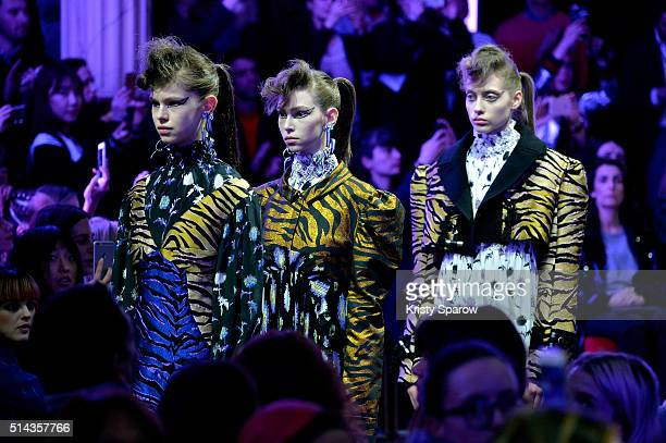 Models walk the runway during the Kenzo show as part of Paris Fashion Week Womenswear Fall/Winter 2016/2017 on March 8 2016 in Paris France