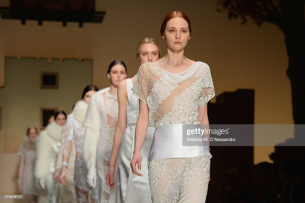 Models walk the runway during the Laura Biagiotti show as part of Milan Fashion Week Womenswear Autumn/Winter 2014 on February 23, 2014 in Milan, Italy.