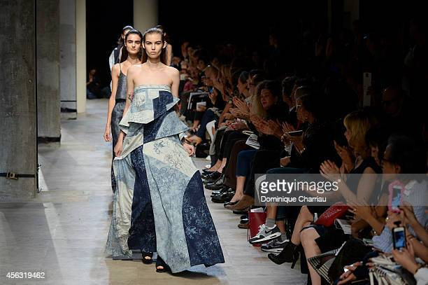 Models walk the runway during the Leonard show as part of the Paris Fashion Week Womenswear Spring/Summer 2015 on September 29 2014 in Paris France