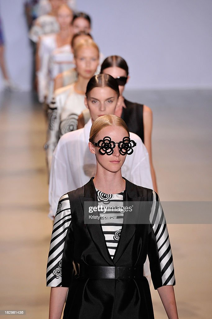 Models walk the runway during the Lie Sang Bong show as part of Paris Fashion Week Womenswear Spring/Summer 2014 on October 2, 2013 in Paris, France.