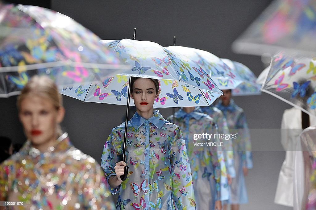 Models walk the runway during the Lie Sang Bong Spring/Summer 2013 show as part of Paris Fashion Week at Les Beaux-Arts de Paris on October 3, 2012 in Paris, France.