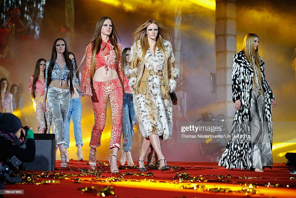 Models walk the runway during the 'Life Ball 2013 - Show' at City Hall on May 25, 2013 in Vienna, Austria.