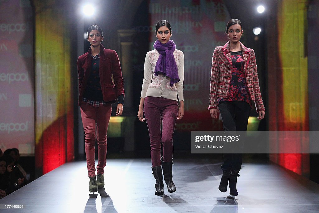 Models walk the runway during the Liverpool Fashion Fest Autumn/Winter 2013 at Club De Banqueros on August 22, 2013 in Mexico City, Mexico.
