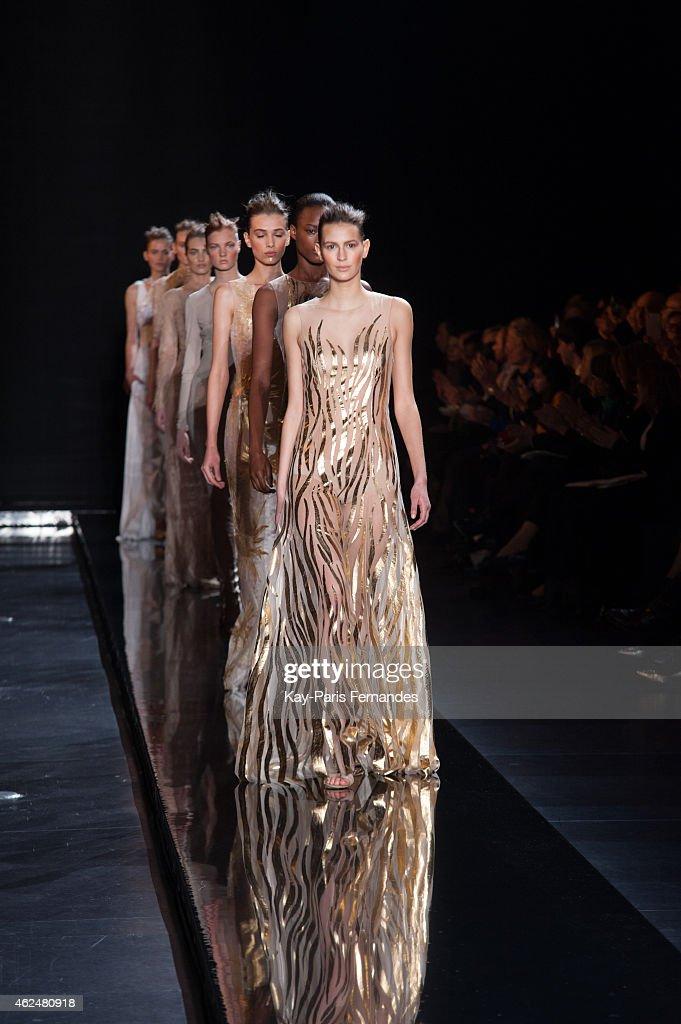 Models walk the runway during the loris azzaro show as part of paris