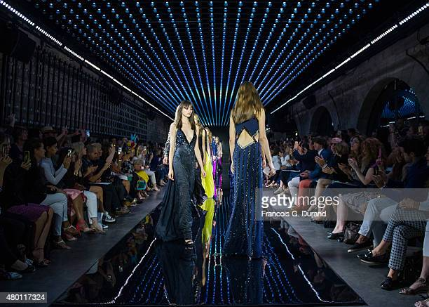 Models walk the runway during the Loris Azzaro show as part of Paris Fashion Week Haute Couture Fall/Winter 2015/2016 on July 9 2015 in Paris France