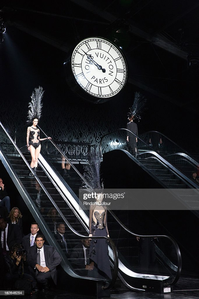 Models walk the runway during the Louis Vuitton show as part of the Paris Fashion Week Womenswear Spring/Summer 2014, held at Le Carre du Louvre on October 2, 2013 in Paris, France.