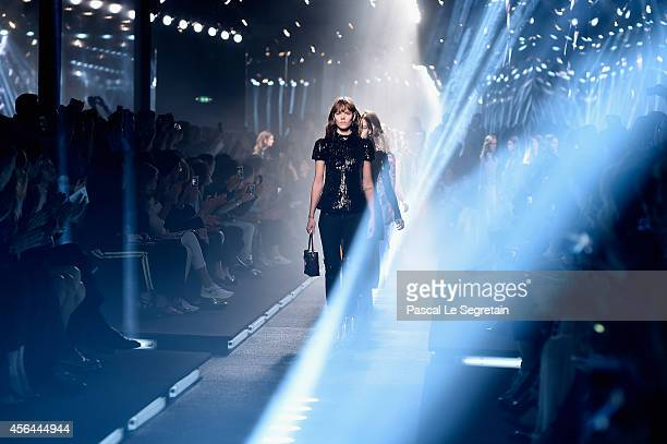 Models walk the runway during the Louis Vuitton show as part of the Paris Fashion Week Womenswear Spring/Summer 2015 on October 1 2014 in Paris France