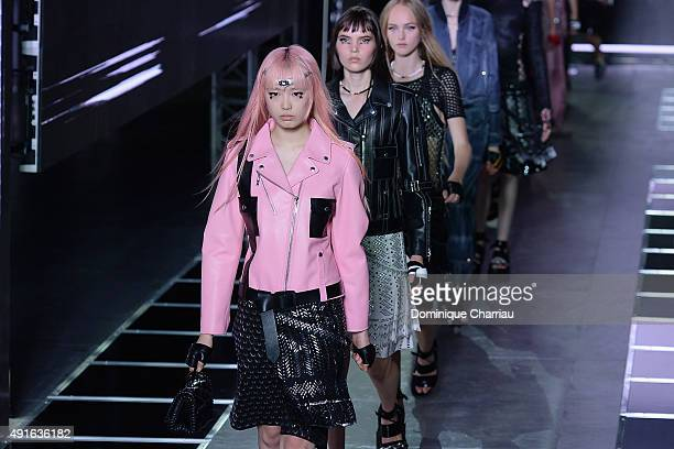 Models walk the runway during the Louis Vuitton show as part of the Paris Fashion Week Womenswear Spring/Summer 2016 on October 7 2015 in Paris France