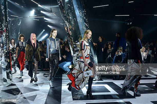 Models walk the runway during the Louis Vuitton show as part of the Paris Fashion Week Womenswear Fall/Winter 2016/2017 on March 9 2016 in Paris...
