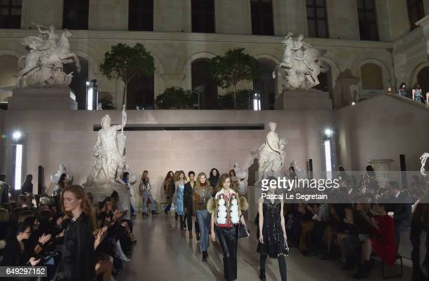 Models walk the runway during the Louis Vuitton show as part of the Paris Fashion Week Womenswear Fall/Winter 2017/2018 on March 7 2017 in Paris...