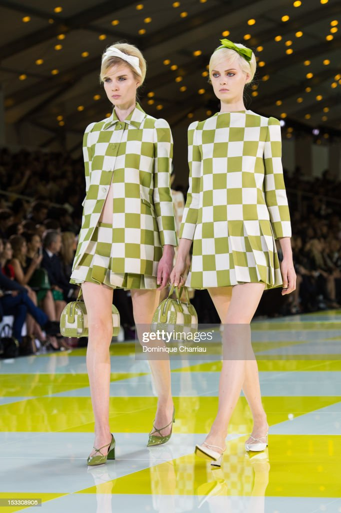 Models walk the runway during the Louis Vuitton Spring/Summer 2013 show as part of Paris Fashion Week on October 3, 2012 in Paris, France.