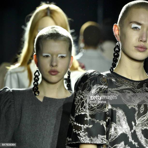 Models walk the runway during the Lutz Huelle show as part of Paris Fashion Week Womenswear Fall/Winter 2017/2018 on March 3 2017 in Paris France